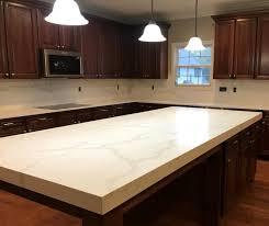 what color countertops go with brown cabinets calcatta verona quartz a quartz countertop that looks like