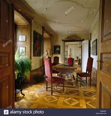 parquet flooring and antique dining table and chairs in period