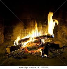 flames of in a fireplace poster id 81285986