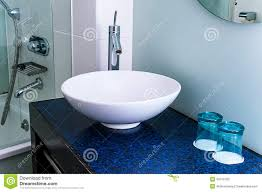 bathroom sink counter tap mixer glass blue stock photo image