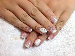 gel nails white nails hand painted nail art geometric design