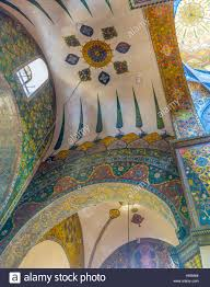 the green floral ornaments cover the semi dome in etchmiadzin
