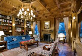 coffered ceilings wood wall paneling blue sofa in a formal
