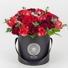 black roses delivery bouquet with tulips in a black box flower delivery in