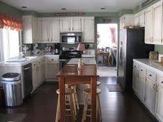Glazing Kitchen Cabinets Before And After by Before And After Rustoleum Cabinet Transformation Pure White W