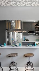gray and white transitional kitchen design with teal blue and