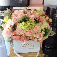 flowers in a box white and pink roses with mixed flowers in white box garden of