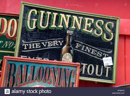 an wooden painted guinness advertising sign for sale