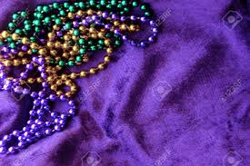 green mardi gras mardi gras to toss gold green and purple on a purple