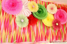 paper fan backdrop daisies and donuts birthday party streamers backdrops and donuts