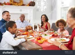 small thanksgiving dinner family grandparents enjoying thanksgiving meal table stock photo