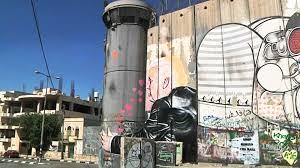 president trump hugs separation wall in west bank mural nbc news
