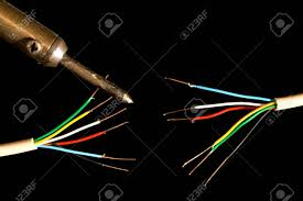 frayed electrical wires and a soldering iron stock photo picture