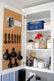 storage ideas for small apartment kitchens kitchen measuring spoons cork boards small apartment kitchen