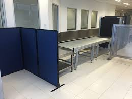 mobile room dividers creating baggage screening areas at sydney airport with portable