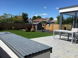 bungalow new turf grey composite decking and granite patio