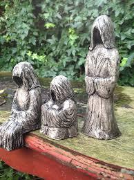 set of 3 faceless hooded figures handmade garden