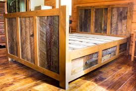 wooden log king size canopy bed frame in rustic bedroom design