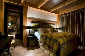 chalet bighorn revelstoke alpine guru double bedroom with fireplace and en suite bath room with separate bath and shower