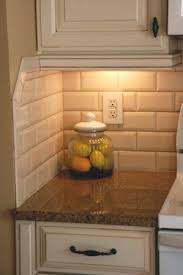 tiled kitchen backsplash this beveled subway tile hton sand by adex cj