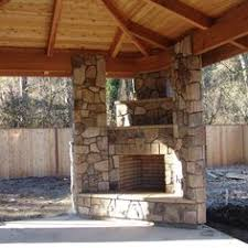 Backyard Fireplace Plans by Traditional Pergola Also Corner Stone Fireplace Design Feat Black