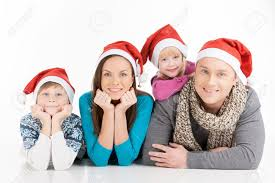 family on cheerful family in santa hats looking at