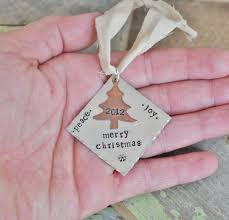 hand stamped personalized christmas ornaments and keepsakes