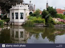 octagonal house reflected into the water edam holland stock photo