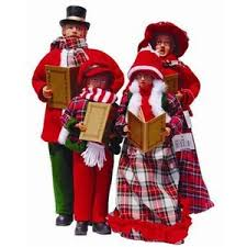 set of four carolers figurines decorations