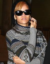 rihanna earrings rihanna punks it up with safety pin earrings as she arrives for x