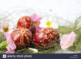 wax easter egg decorating easter eggs decorated with wax and flowers on straws stock photo