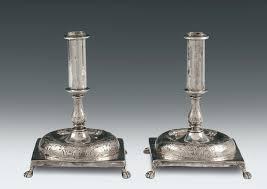 candelieri in argento coppia di candelieri in argento fuso sbalzato e cesellato bollo