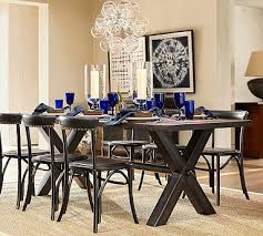 we paired an iron framework with a blackened rustic pine top to