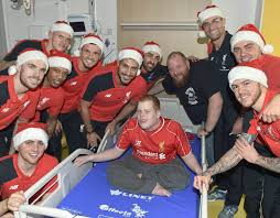 deliver presents liverpool players deliver christmas presents to children s