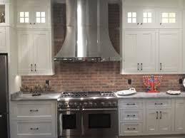 interior farmhouse kitchen with brick backsplash and copper