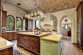 mediterranean kitchen with u shaped u0026 hardwood floors in west lake