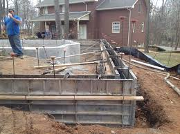 concrete wall vinyl liner pool under construction with retaining