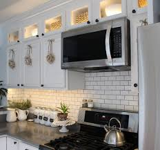 how to install lighting your kitchen cabinets how to install kitchen cabinet lighting the honeycomb home