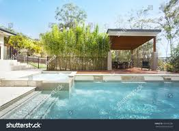 modern backyard entertaining area pool stylish stock photo