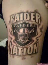 raider face skull tattoo on back tattoo viewer com