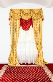 yellow curtains in the room with red carpet stock photo image