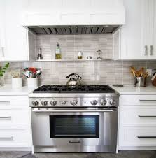 white kitchen cabinets with stainless steel backsplash 29 stainless steel backsplash ideas leave you spellbound