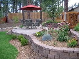 fantastic backyard with rock garden ideas also hanging flowers
