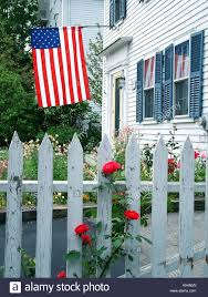 State Flag Of Massachusetts White Picket Fence Red Roses And American Flag On July 4th In