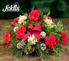Christmas Hurricane Centerpiece - the belmore christmas hurricane centerpiece by feldis florist