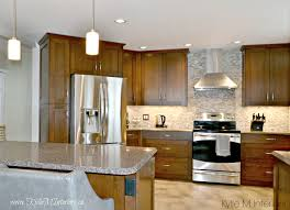 kitchen with stainless steel appliances oak kitchen remodel wood cabinets quartz countertops and