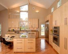natural maple cabinets with caeserstone desert limestone counters