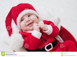 smiling baby in santa cap and royalty free stock images