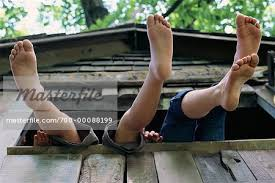 file tree house jpg feet hanging from tree house stock photo masterfile rights