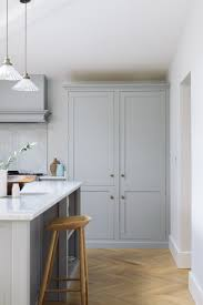 modern shaker kitchens a wonderful big larder cupboard provides lots of storage in this